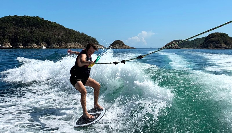 Philip finds wakesurfing a good way to beat the heat.